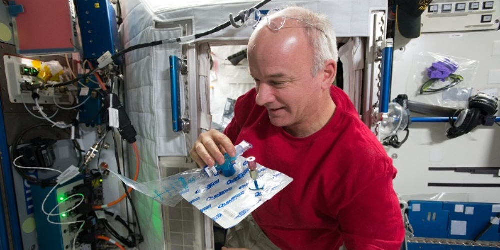 Photo of astronaut Jeff Williams collecting a sample of his breath for MARROW, a Canadian experiment