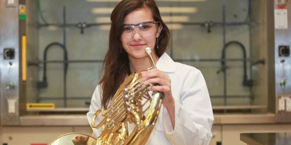 Photo of Margaret Watson with her instrument in a science laboratory