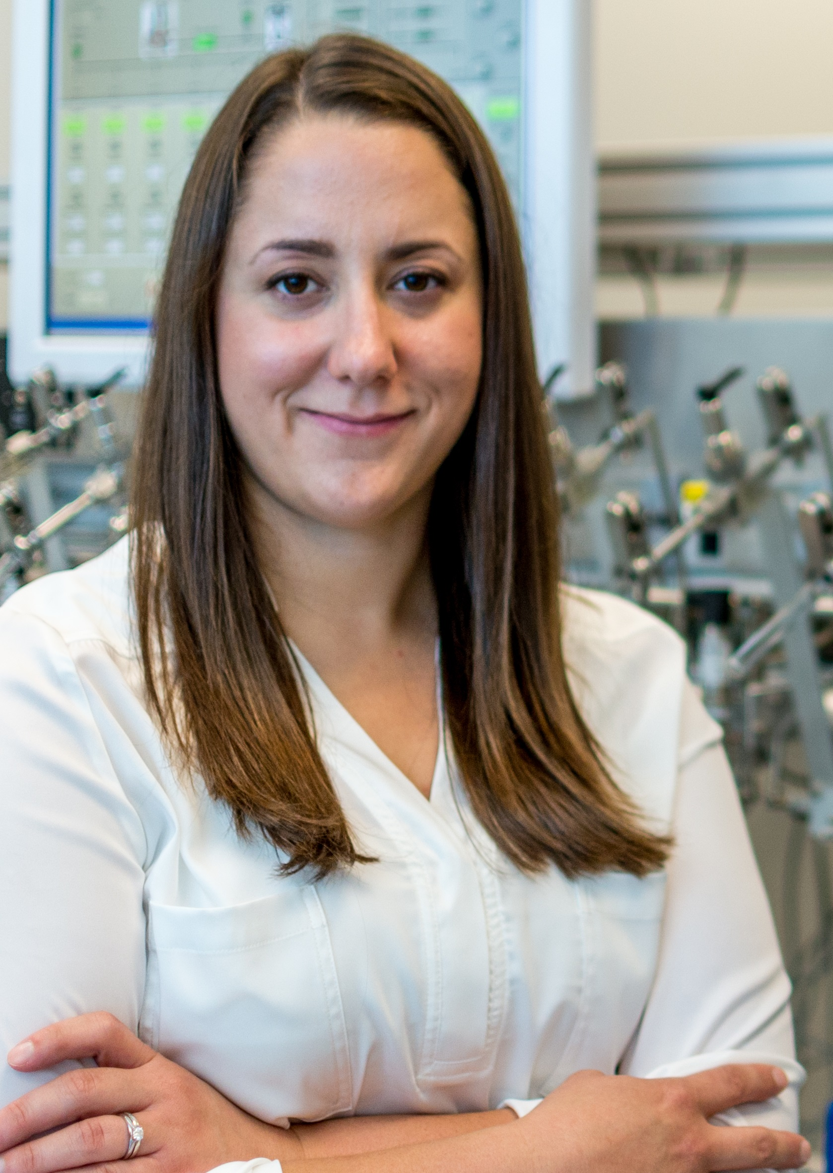 Sarah Murseli wearing a labcoat in a laboratory