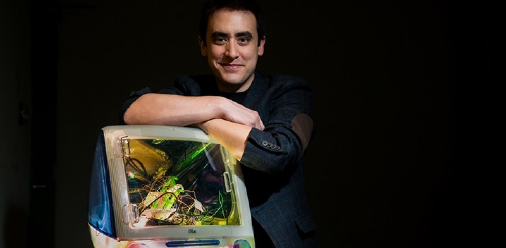 Andrew Pelling holding one of his scientific creation