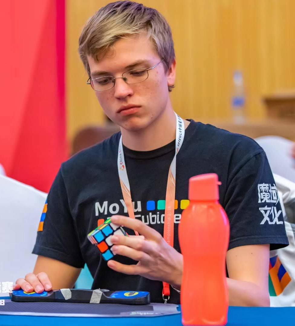 Antoine Cantin solving a Rubik Cube during an international competition