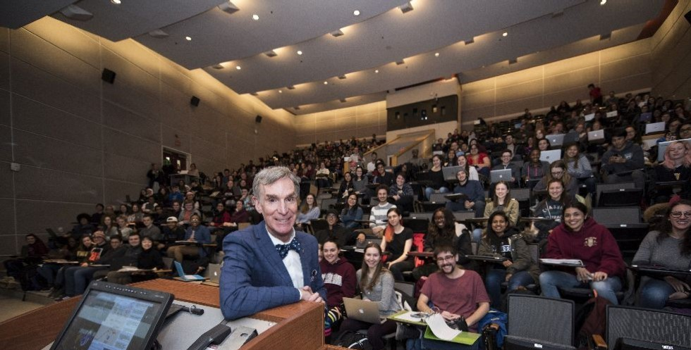 Bill Nye with students posing in Marion auditorium