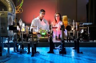 Two students working in a physics laboratory
