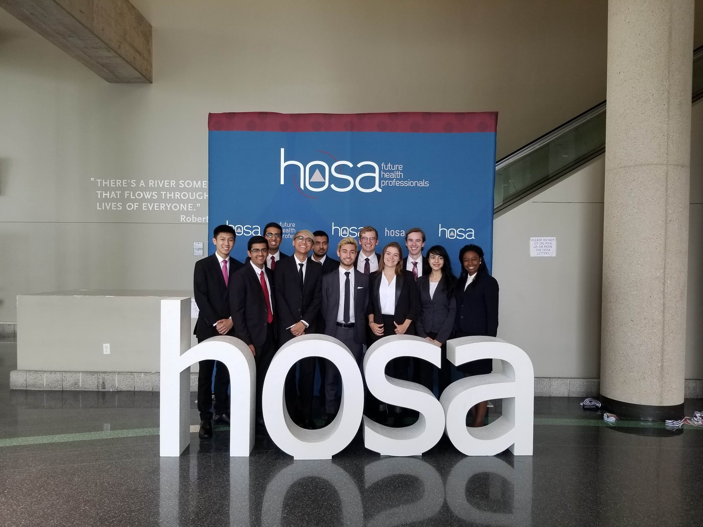 students behind HOSA sign