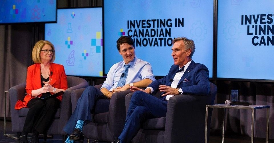 PM Justin Trudeau and BIll Nye talking in front of a crowd