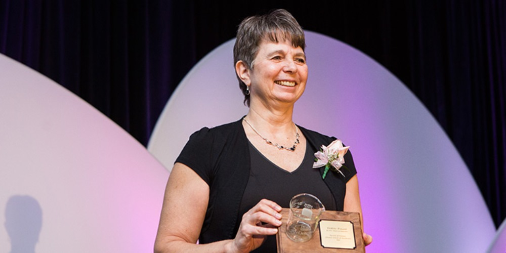 Photo of Debbie Pinard, 2015 recipient accepting the prize
